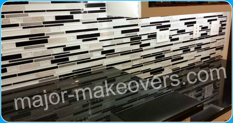 Gray strips of stone combined with white, black and grey strips of glass tile, forming a bright and beautiful backsplash tile installed in Hinsdale, IL 60521.