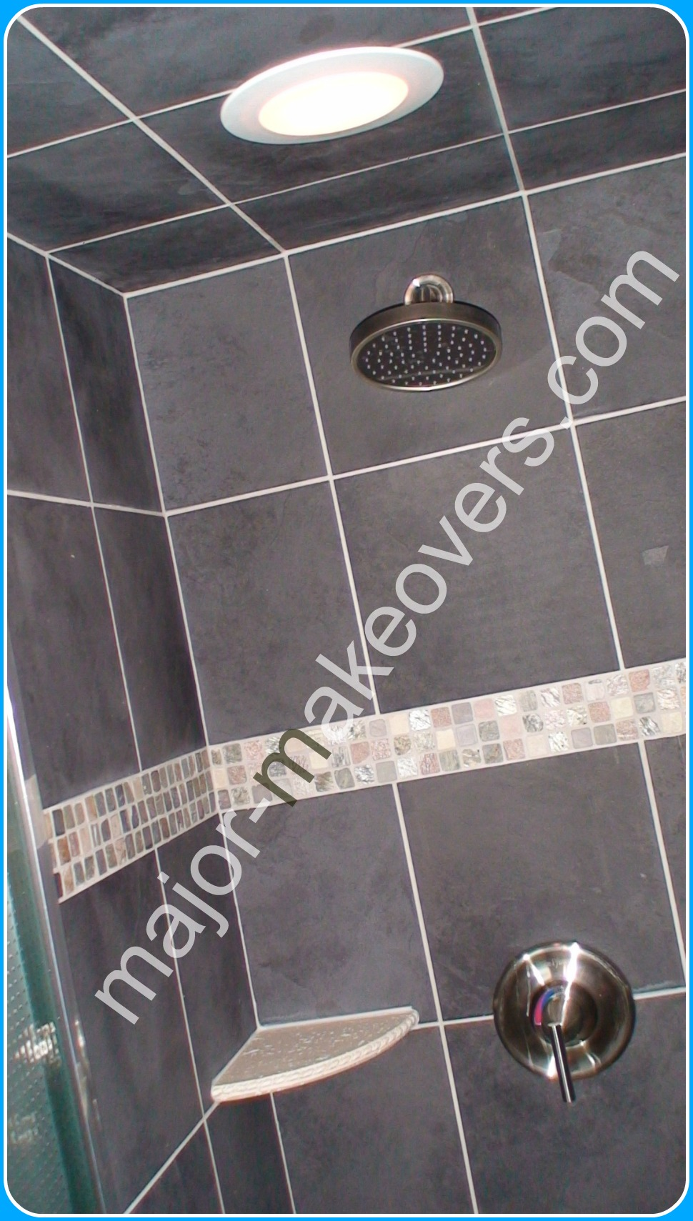 Basement shower tile as 12x12 inch black ceramic including on the shower ceiling. Decorative tile line and 2 corner soap dishes complete the tile installation.