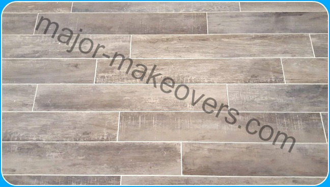 Close-up on Capella Ash porcelain tile to reveal the rustic/antique wood look particularities imitating old barn wood.
