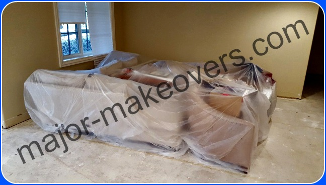 Plastic sheets covering couches/furniture and other objects to protect from dust.