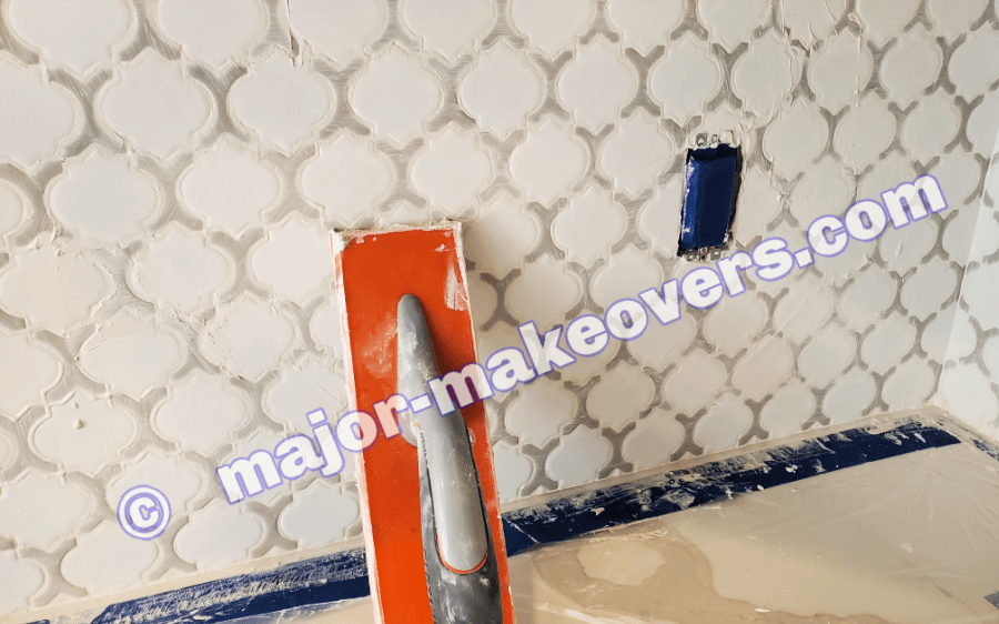 Grout time! Grouting is a messy, muddy work which is the main reason to have the plastic sheets taped over your countertops in the first place. Best Scottsdale Backsplash Tile Installation