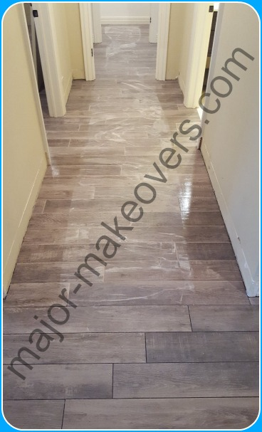Grout application on hallway porcelain tile seen after spreading but before washing/cleaning the extra grout.