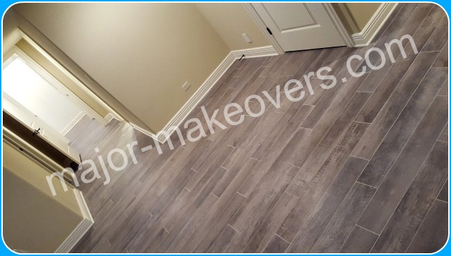 Porcelain tile installed perpendicularly with this basement hallway.