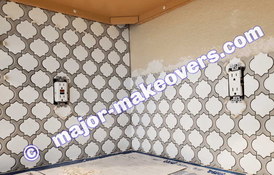 Tile design/pattern must flow from one wall to the next at corners under cabinets.