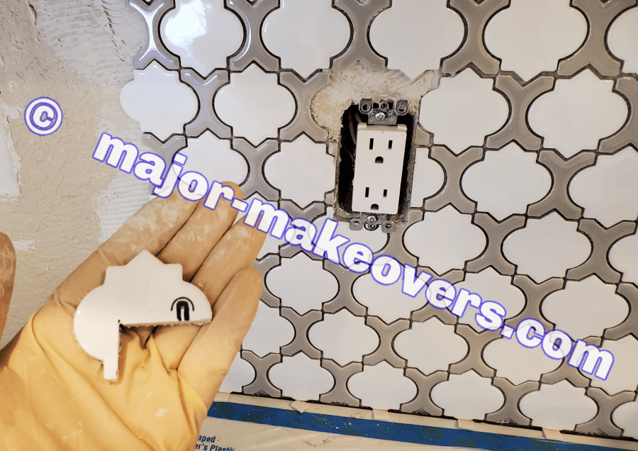 Making difficult tile cuts and installing tiny tile pieces around a backsplash electrical outlet or switch.