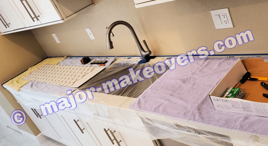 Towels and cardboard protect your counters even more during tile installation for your kitchen backsplash in Phoenix, Scottsdale, etc.