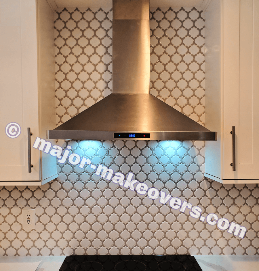 Wall mounted range hood was installed back in its place and the tile runs everywhere behind it for the best look. Gorgeous new kitchen backsplash!