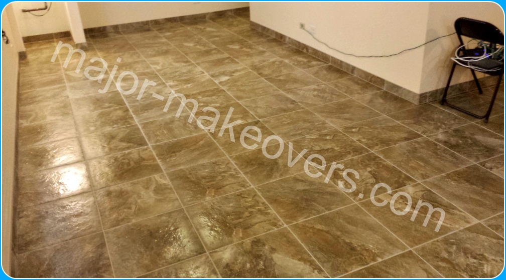 18 by 18 inch porcelain tile covering most of this Minooka, IL basement including the 4 in. custom cut and matching baseboard tile.