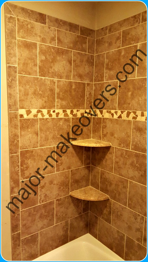 9x12 inches ceramic tile installed in a brick style on tub walls with decorative travertine tile line, 2 corner soap dishes and bullnose tile on edges.