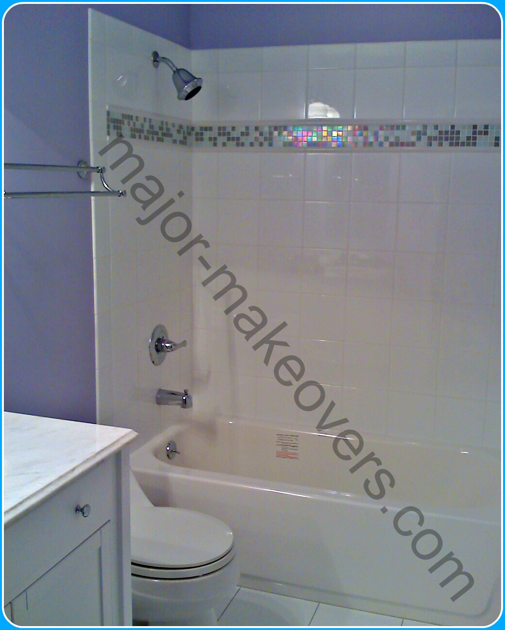 6x6 white ceramic tile installed on tub surround walls with matching length bullnose to finish edges. Decorative strips of 2 tone mosaic at eye-level with white pencil tile.